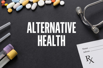 ALTERNATIVE HEALTH written on black background with medication