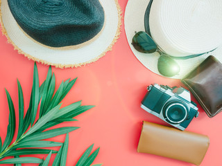 flat lay for summer cloth and accessories concept with red background and two beach hat
