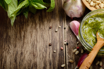 Top view of Pesto sauce and ingredients on wood table with copy-space