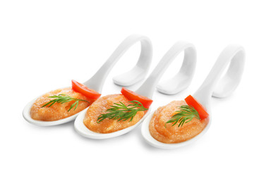Delicious cod caviar in ceramic spoons on white background