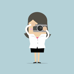 Businesswoman takes a picture with camera. vector
