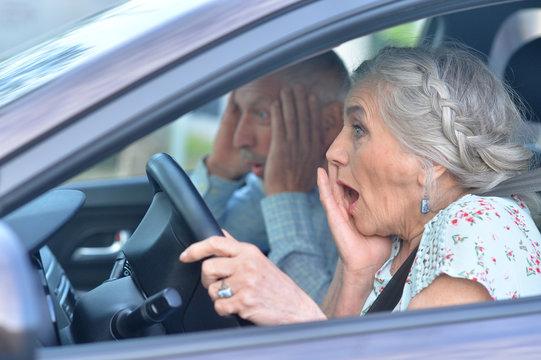 senior couple driving car