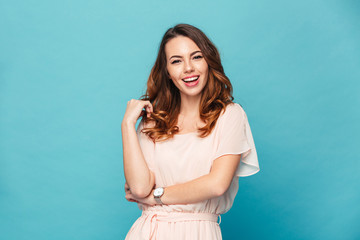 Happy young lady over blue background. Wall mural