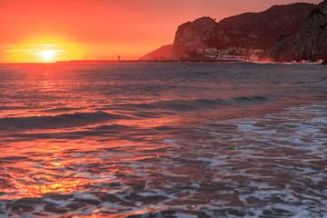 Mediterranean sea sunset at Port Ginesta beach, Sitges, Catalonia, Spain.