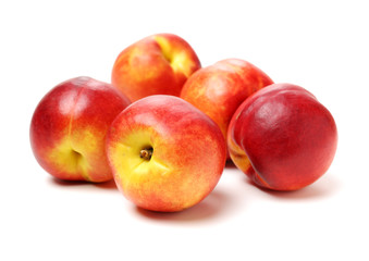 Bunch of nectarines on white background