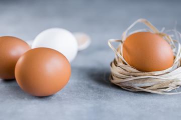 Raw chicken eggs on gray background.
