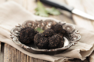 Black truffles on plate.