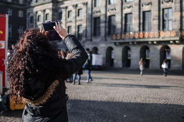 Photograph of a girl in the streets of Amsterdam