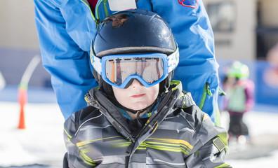 Toddler Boy Dressed Warmly & in Good Safety Gear Ready to go Ski