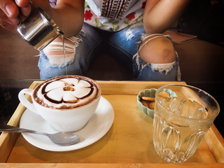Hot cocoa put honey in the coffee cafe.