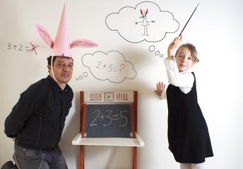 Little girl teaching mathematics to an adult dunce