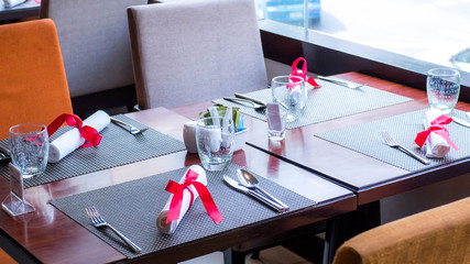 Table setting, interior elements and silverware in Hotel restaurant, Valentine Theme