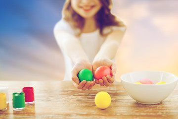 close up of girl holding colored easter eggs