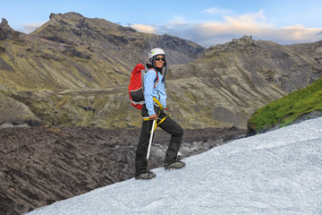 Young woman standing on Falljokull Glacier
