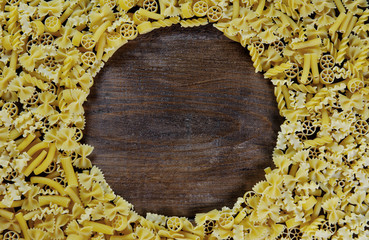 Pasta background - mix of italian pasta on wood