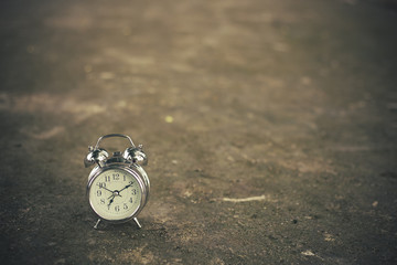 Retro clock on brick floor