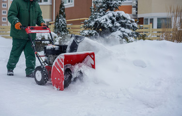 Man Removing Snow with a Snow Blower Winter