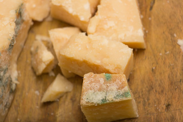 Dairy product parmesan cheese on board.