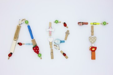 Word ART made by colorful clothespins with hearts and animals on white background
