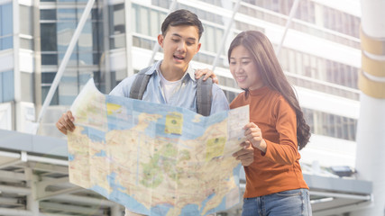 traveler couple people use generic local map and talk at urban city. Honeymoon trip, holiday vacation travel concept.
