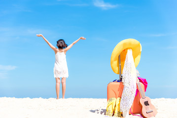 Summer traveling with ukulele and Fashion woman swimsuit Bikini, fish star, sun glasses, camera and hat on the sand beach in the holiday, blurry freedom and lifestyle woman background.