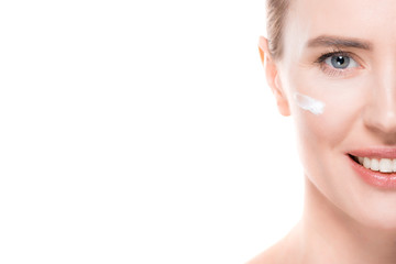 Cropped view of female with cream on face skin isolated on white