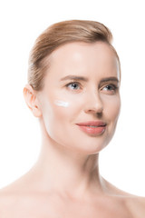 Woman with cream on face isolated on white