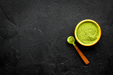 Japanese traditional product. Matcha green tea in bowl on black background top view copy space