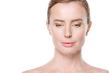 Woman with painted lines on face for plastic surgery isolated on white
