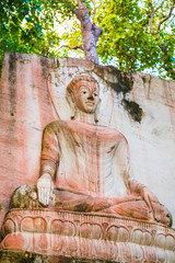 Carving Buddha art on rock in Huai Pha Kiang temple