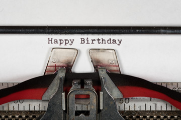 Macro detail of Happy Birthday on electric typewriter with ribbon