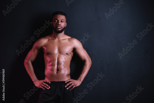 muscular bare-chested african american man standing with hands on ...