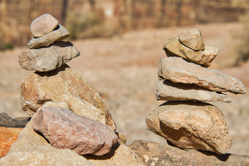 Rocks in the desert stacked together in two piles.