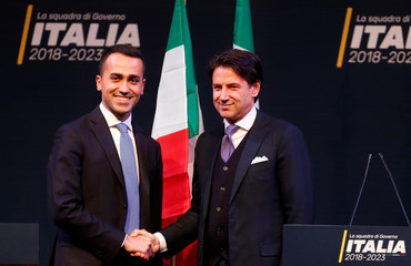 5-Star Movement leader Di Maio shakes hands with Giuseppe Conte, who would be Minister for Simplification of Public Administration with the Parliament in any 5-Star government, during the presentation of the would-be cabinet team, ahead of election in Rome