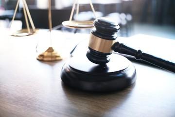 Judge gavel hammer with smartphone on Lawyer desk.