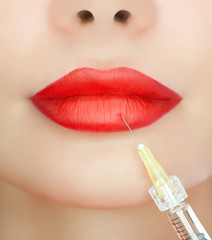 The doctor cosmetologist makes the Rejuvenating injections on the lips of a beautiful, young woman. Cosmetology concept.