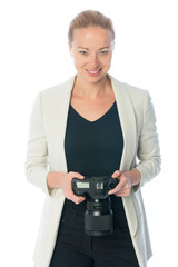 Woman photographer holding big dslr camera isolated on white background.