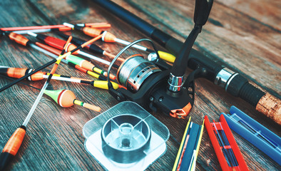 Fishing tackle on a old wooden table. Sport and recreation concept