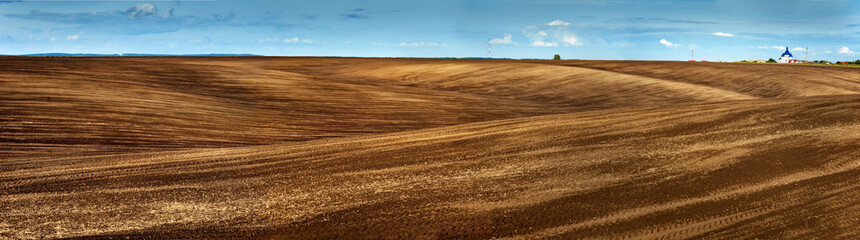 Lines of arable land landscape panorama
