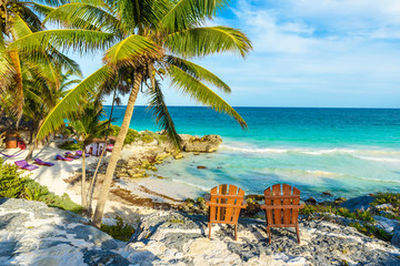 Recreation at paradise beach resort with turquoise waters of Caribbean Sea at Tulum, close to Cancun, Riviera Maya, tropical destination for vacation, Mexico