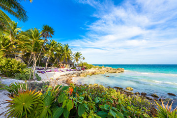 Recreation at paradise beach resort with turquoise waters of Caribbean Sea at Tulum, close to Cancun, Riviera Maya, tropical destination for vacation, Mexico Wall mural