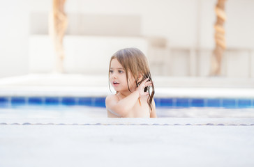 girl with wet hair in the swimming pool