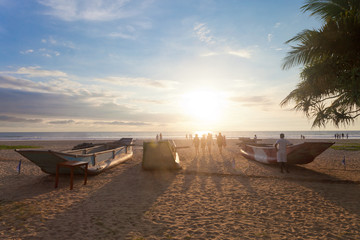 Ahungalla, Sri Lanka - Traditional longboats at Ahungalla Beach during sundown
