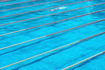 Municipal swimming sport pool. Texture of blue water in the pool. Bright abstract background ideal for any design