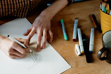 Hand lettering artist drawing picture
