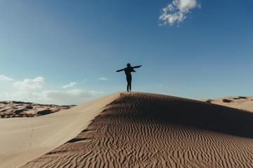 Woman enjoying freedom in the desert