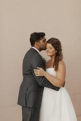 Groom Giving Bride a Forehead Kiss