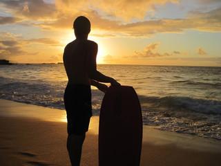 Silhouette of skim boarder