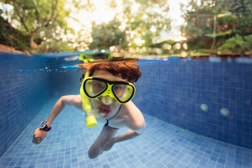 Split image of a boy with snorkel and mask in a swimming pool