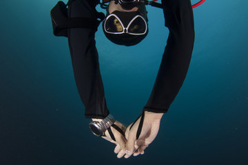 Male diver stretch arms